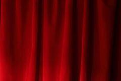 Red Velvet Drapes. Image of red velvet drapes, lit with a single light from the left to create dramatic effect Royalty Free Stock Photo