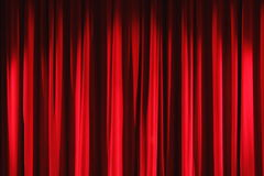Red velvet drapes curtain Royalty Free Stock Image