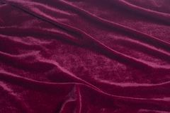 Red velvet fabric background texture. Close up stock photography