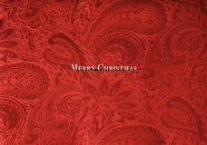 Red velvet fabric with a vintage elegant floral pattern luxury Christmas card design. With Merry Christmas text Stock Photography