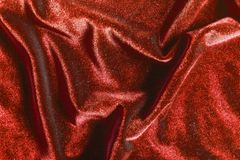 Red velvet folds texture background stock photo