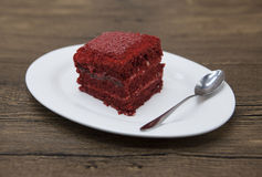 Red Velvet, fresh delicious diet cake  at Dukan Diet on a porcelain plate with a spoon  on a wooden background. Stock Photos