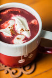Red Velvet Hot Chocolate. A cup filled with red velvet hot chocolate topped with cream cheese and dusted with cinnamon Royalty Free Stock Photos
