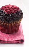 Red velvet muffin with chocolate sprinkles Royalty Free Stock Image