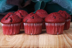 Red Velvet Muffins. Shot of several red velvet muffins on a wooden board Royalty Free Stock Image