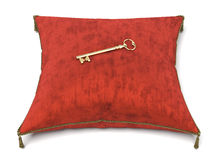 Red velvet pillow and key. Isolated on a white background. 3d render Stock Image