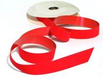 Red Velvet Ribbon. Spool of red velvet ribbon, shiny on one side, velvet on other Royalty Free Stock Photos