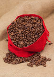Red velvet sac with coffee beans Stock Photo