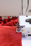 Red velvet and a sewing machine Royalty Free Stock Photography