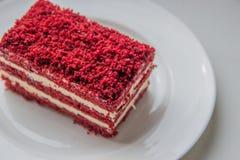 Red velvet slice of cake on white plate Stock Images