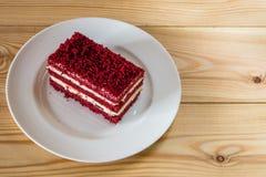 Red velvet slice of cake on white plate Stock Photos