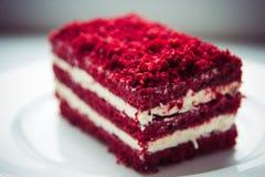 Red velvet slice of cake on white plate Royalty Free Stock Photography