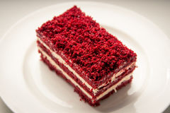 Red velvet slice of cake on white plate Royalty Free Stock Photo
