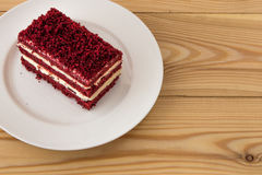 Red velvet slice of cake on white plate Stock Photos