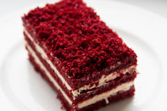 Red velvet slice of cake on white plate Stock Images