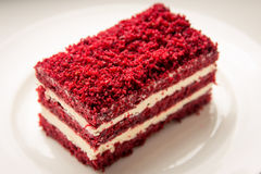 Red velvet slice of cake on white plate Royalty Free Stock Photography