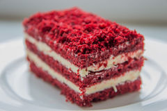 Red velvet slice of cake on white plate Royalty Free Stock Images