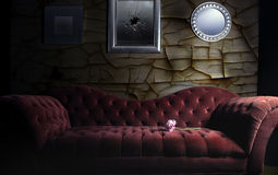 Red Velvet Sofa. In a living room that is in ill repair Stock Photos