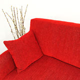 Red velvet sofa and willow branches in a vase Royalty Free Stock Images