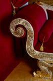 Red velvet textile sofa in the interior room studio Royalty Free Stock Photos
