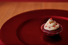 Red Velvet Valentine Cupcake. Red Velvet Valentines Cupcake with Buttercream icing and heart decorations Royalty Free Stock Photo