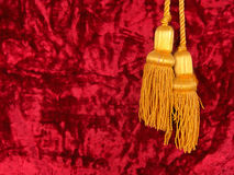 Red velvet with yellow tassels. It is a part of one russian flag Royalty Free Stock Image