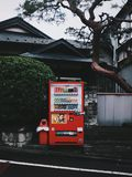 Red Vending Machine In Front Of A House Stock Photos
