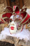 Red Venetia Mask on Rock Stock Photos