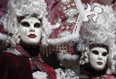 Red venetian carnival. Mask twins Royalty Free Stock Photos