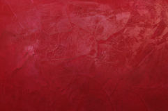 Red Venetian decorative plaster. Beautiful texture decorative Venetian stucco for backgrounds Stock Photos