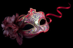 Red venetian mask from above. A decorative bright red venetian mask photographed from above isolated on a black background royalty free stock photography