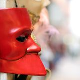 Red Venetian mask for sale in calle of Venice Stock Images