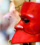 Red Venetian mask for sale in calle of Venice Royalty Free Stock Image