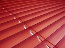 Red venitian blinds. Deep red venitian plastic window blinds Royalty Free Stock Image
