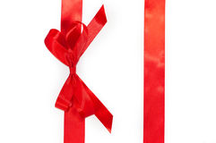 Red vertical gift ribbons and luxurious bow Stock Photography