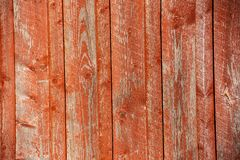Red vertical wood paneling in sunlight royalty free stock photo