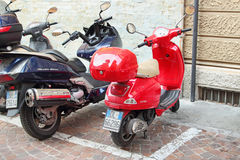 Red Vespa motocycle Stock Images
