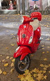 Red Vespa parked at Munich street Stock Photo