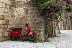 Red Vespa scooter, Rhodes Island, Rhodes town, Greece stock image