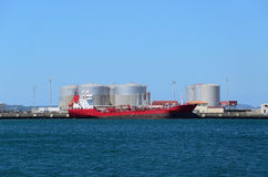 Red vessel and tanks Stock Photo