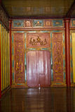 Red Vietnamese door in a palace. Hue, Vietnam. Red door and gilded wood in a Vietnamese palace. Hue, Vietnam Stock Photo