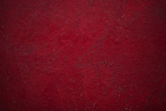 Red vignette texture. Red textured wall with strong vignette effect Royalty Free Stock Photography