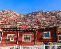 Red village and monastery at Larung gar Buddhist Academy in Sichuan. Top view monastery at Larung gar Buddhist Academy in sunshine day and background is blue sky Royalty Free Stock Photo