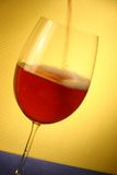 Red vine glass. Red wine being poured in a glass Stock Photography