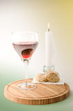 Red vine in a glass with candle Stock Photos