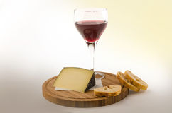 Red vine in a glass with cheese and bread 2 Royalty Free Stock Photography