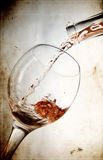 Red vine in glass on vintage background royalty free stock photography