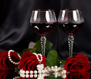 Red vine glasses with red roses Royalty Free Stock Photography