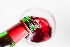 Red vine pouring into glass Stock Images