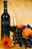 Red vine with red grapes and flower Royalty Free Stock Images